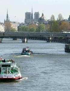 bateau-mouche_and_barges_on_the_seine_river_paris_france_photo_gov