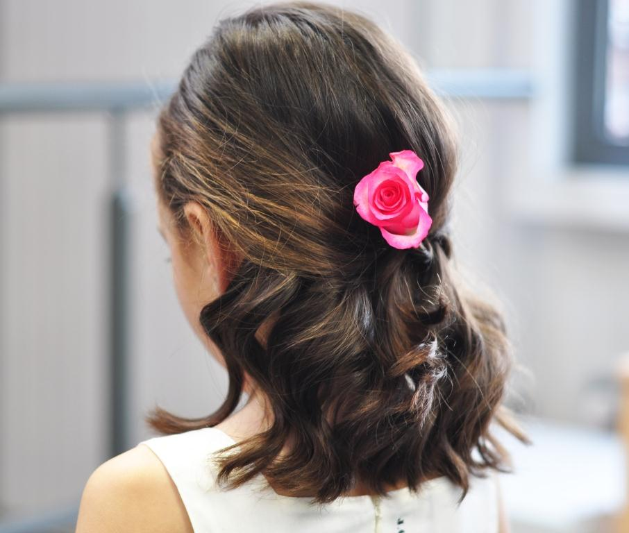 girls hairstyle with flower